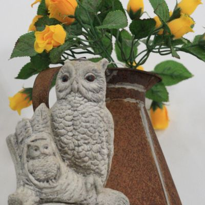 Owl with rustic jug
